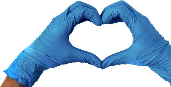 Blue gloves on hands in the shape of a heart