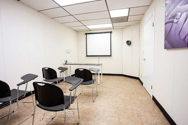Classroom with chairs and projection screen