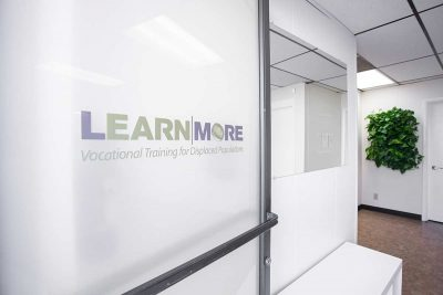 LearnMore Logo on a door