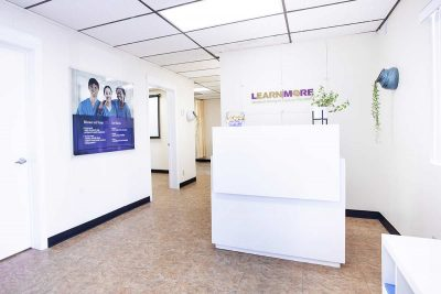 Reception area of the school: logo, desk and mission statement