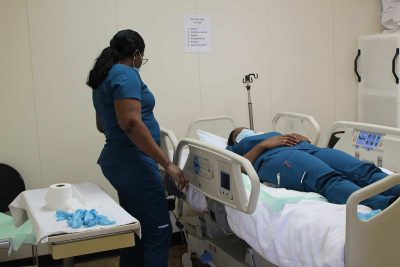 Learn More Fast students role playing as nurse and patient