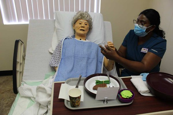 Learn More Fast student working with a mannequin patient