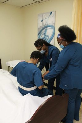 Learn More Fast students practicing lifting another patient