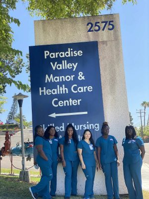 Learn More Fast students in front of hospital sign